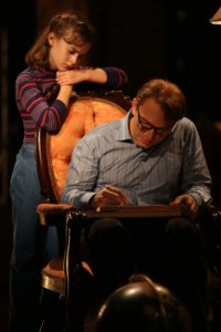 Sydney Lucas and Michael Cerveris in Fun Home, with music by Jeanine Tesori, book and Lyrics by Lisa Kron, based on the Alison Bechdel book, and directed by Sam Gold, running at The Public Theater at Astor Place. Photo credit: Joan Marcus.