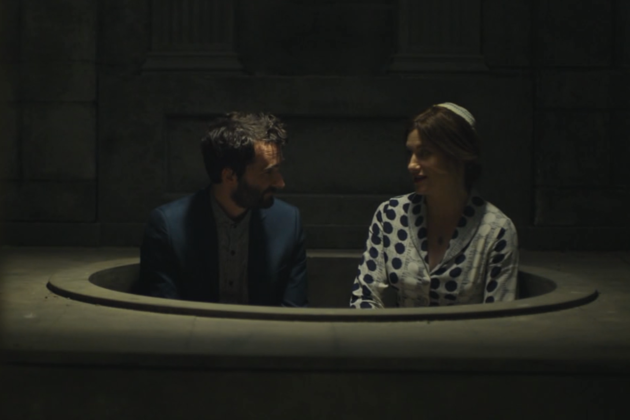 Josh and Raquel in the empty mikveh.