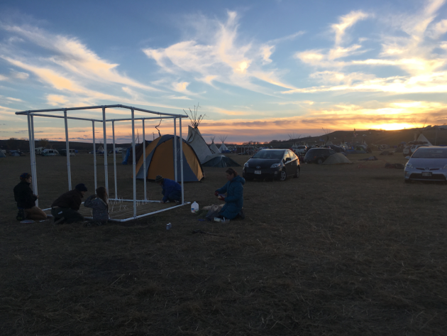 Building our sukkah at Oceti Sakowin with the help of our neighbors.