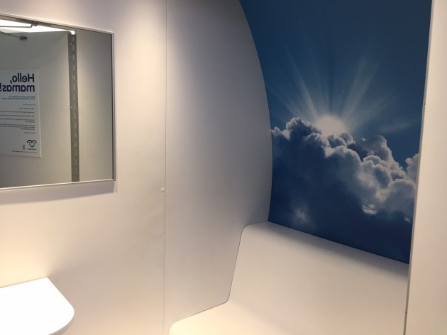The interior of the mamava pod—all white except for cloud mural on one wall. Photo credit: Amy Stone.