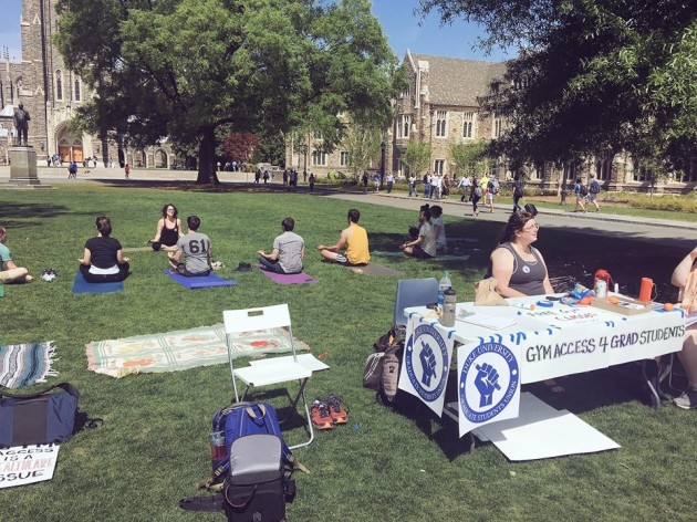 Gokhberg teaches yoga; Issacharoff at the table.  (Photo from Duke Graduate Students Union's Facebook Page.)