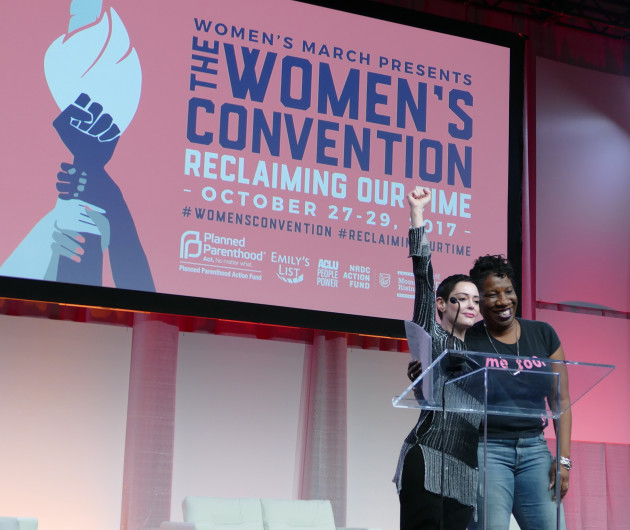 Actress Rose McGowan, left, and Tarana Burke who founded #metoo ten years ago, standing together at opening session of the Women's Convention.