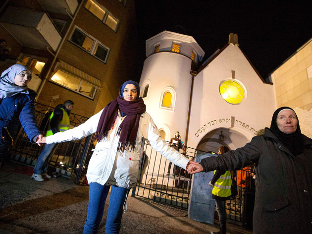 Muslims form a protective circle around Jews praying at a synagogue in Oslo, Norway, 2015.