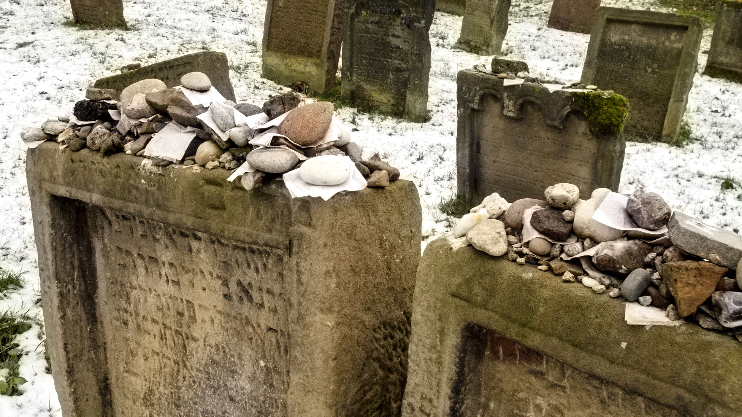 Two Gravestones with Rocks Placed Atop