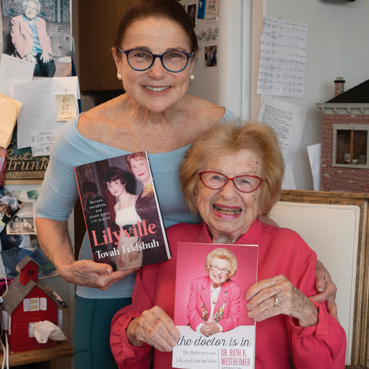 Tovah & Dr. Ruth grin holding copies of their respective books.
