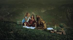 Three women gather in a meadow